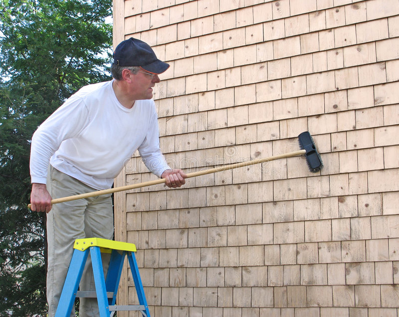 Download Man Cleaning Cedar Shingles Stock Photo - Image: 4530240