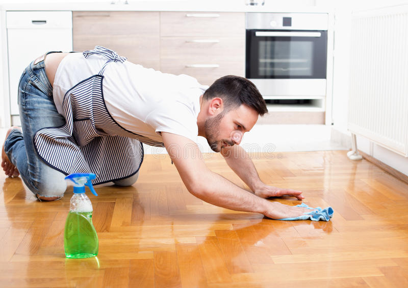 Man cleaning floor royalty free stock photos