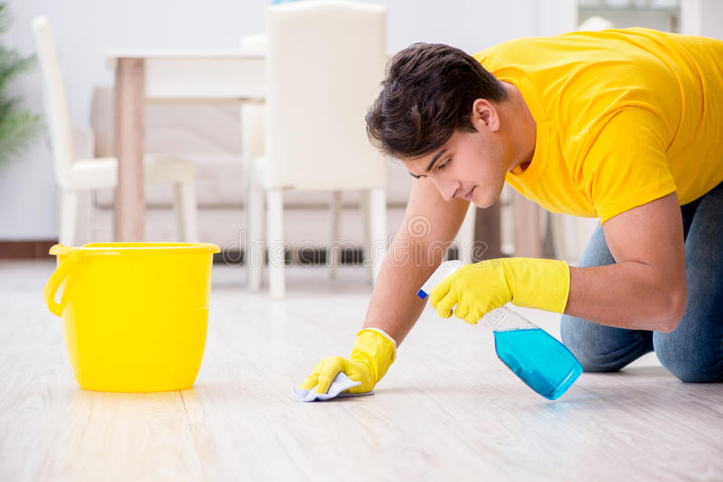 The man cleaning the house helping his wife. Man cleaning the house helping his wife royalty free stock photography