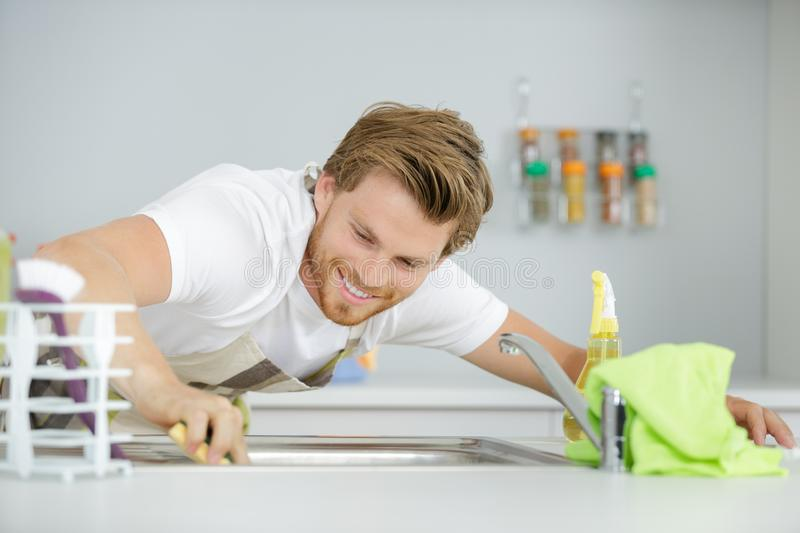 Man cleaning the sink. Cleaning stock photo