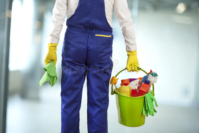 Man with cleaning supplies in building royalty free stock photography