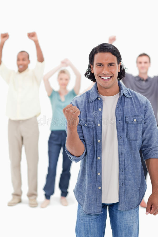 Download A Man Clenching His Hand With People Raising The Stock Photo - Image: 23012982