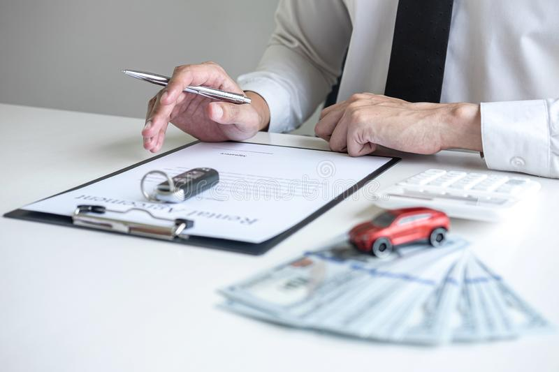 Man client calculating insurance premium for decide signing rental contract form of renting a vehicle agreement, car insurance. Concept royalty free stock images