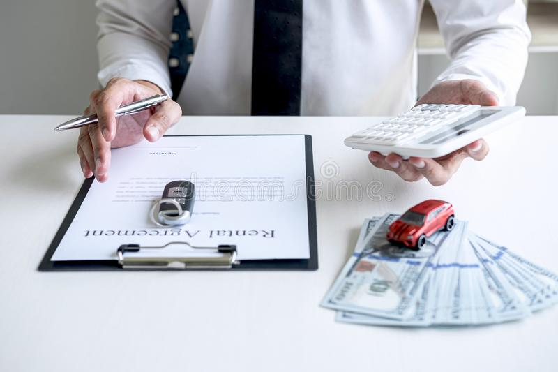 Man client calculating insurance premium for decide signing rental contract form of renting a vehicle agreement, car insurance. Concept stock photo