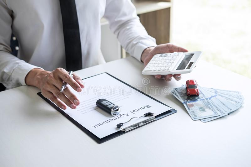 Man client calculating insurance premium for decide signing rental contract form of renting a vehicle agreement, car insurance. Concept stock photos