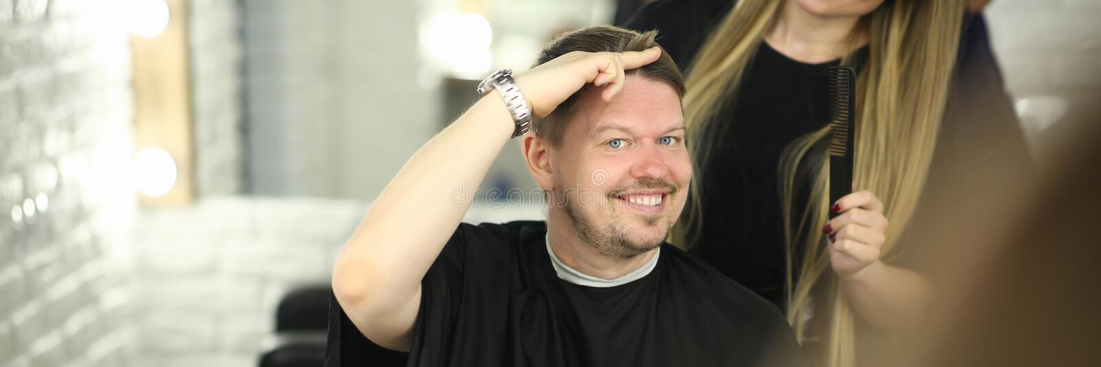 Man Client Showing Haircut Style in Beauty Salon royalty free stock images