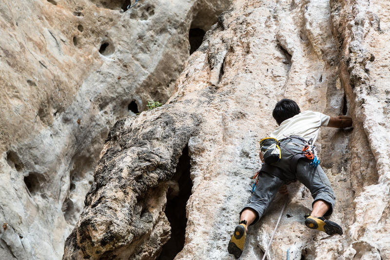 Man cliff climbing. Man on cliff climbing sport royalty free stock images