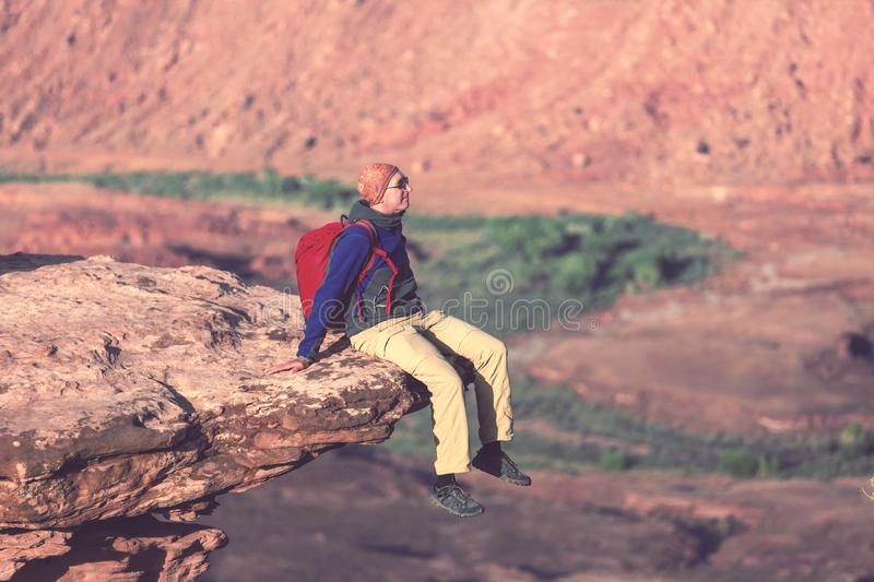 Man on the cliff stock image
