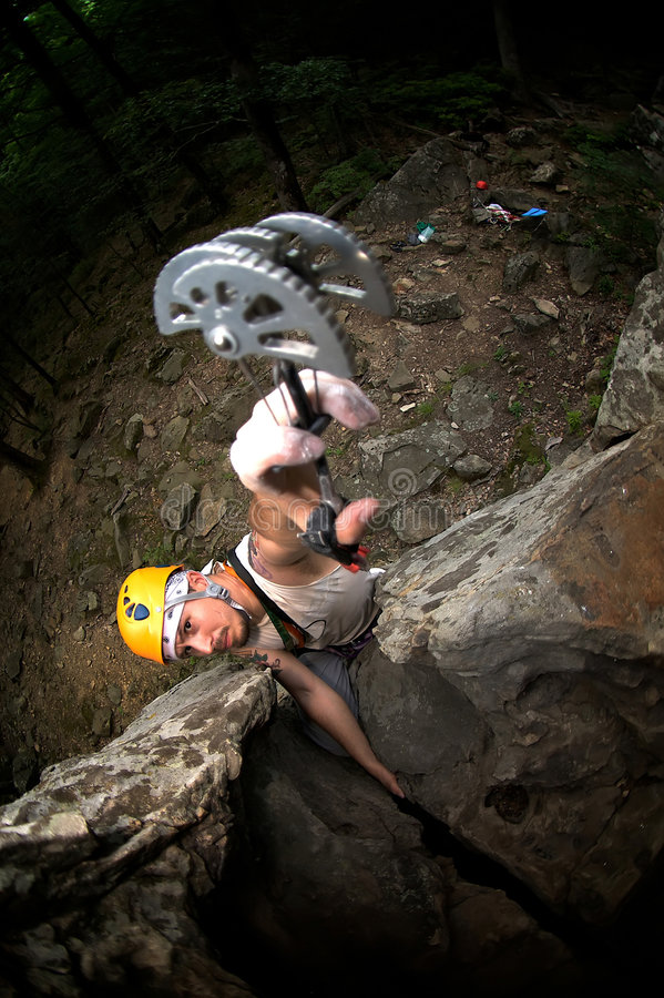 Man climb on rock. In helmet and with friend royalty free stock photography