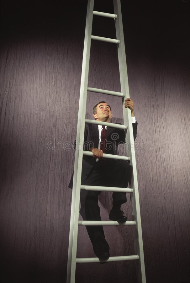 Man climbing corporate ladder with rung missing royalty free stock photography