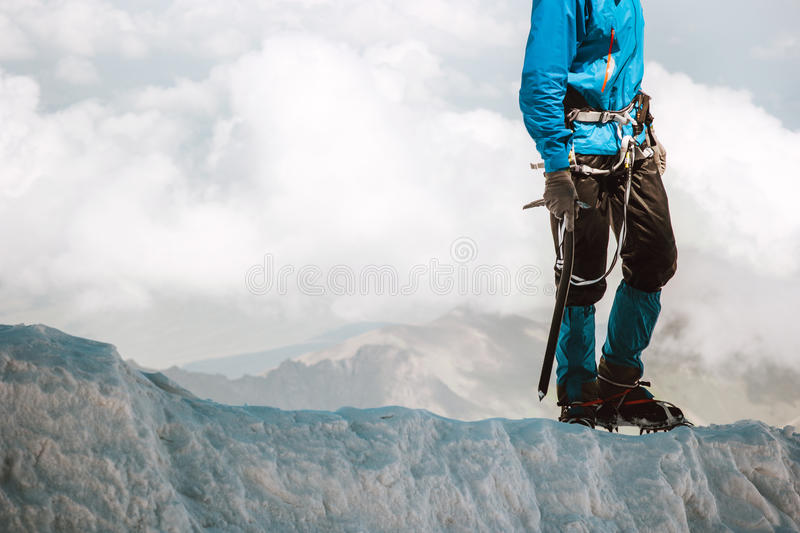 Man climbing on glacier to mountain summit Travel. Lifestyle concept adventure active vacations outdoor mountaineering sport alpinism equipment ice axe and royalty free stock image