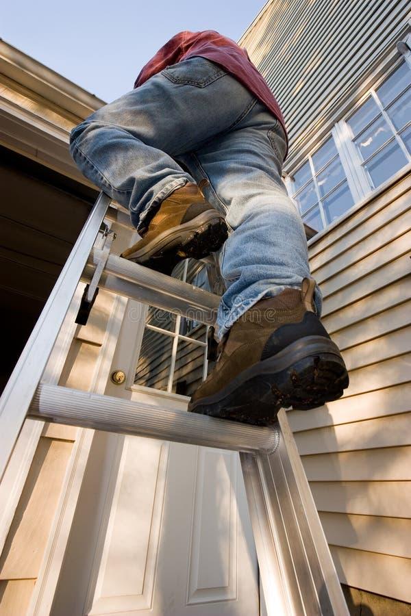 Man Climbing Ladder stock image