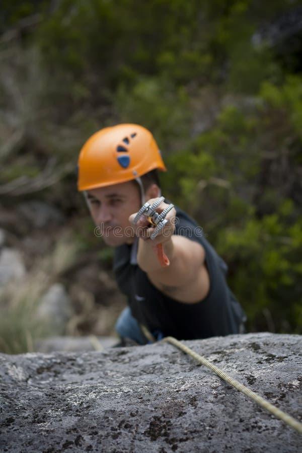 Man climbing a mountain stock images