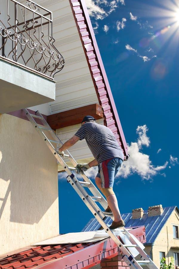 Free Man Climbing The High Position Stock Photos - 58722053