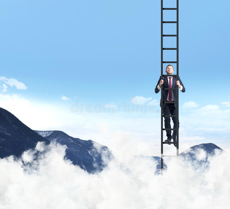 A man is climbing up the ladder. Clouds and mountain landscape. royalty free stock photos