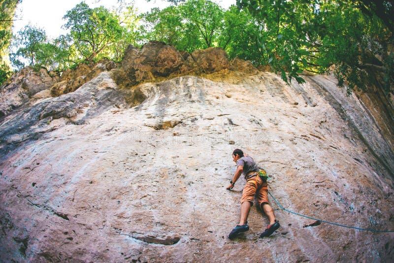Man climbs a rock. stock photography