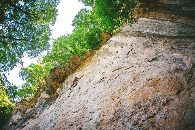 Man climbs a rock. stock images