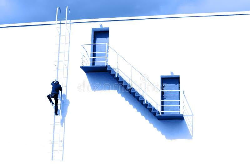Man climbs the stairs up stock photos