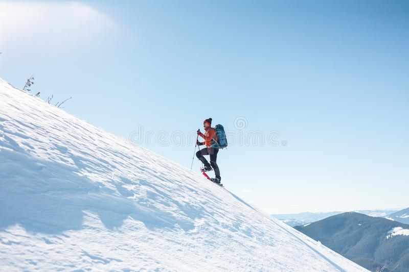A man climbs to the top of the mountain. royalty free stock photos
