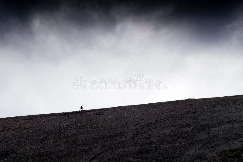 A man climbs up the hill. Russia royalty free stock photos