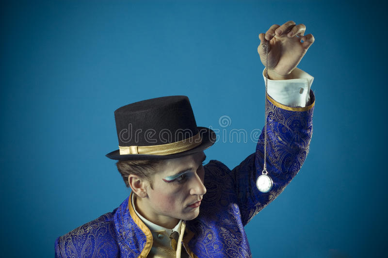 Man with a clock. Man enters into hypnosis by means of a pocket watch stock images