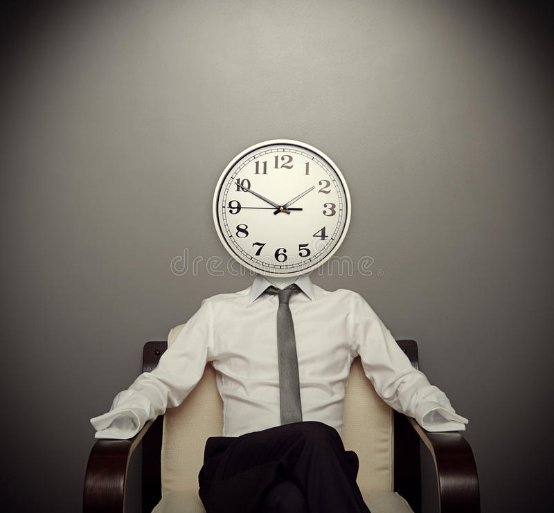 Man With A Clock Instead Of A Head Stock Images Image