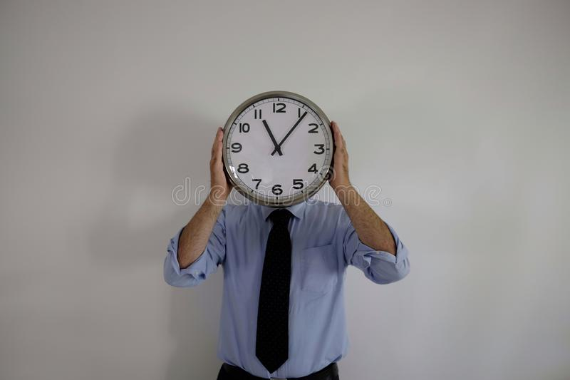 Man with clock on his face stock image