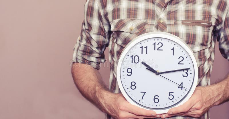 Man with a clock in his hands royalty free stock photos