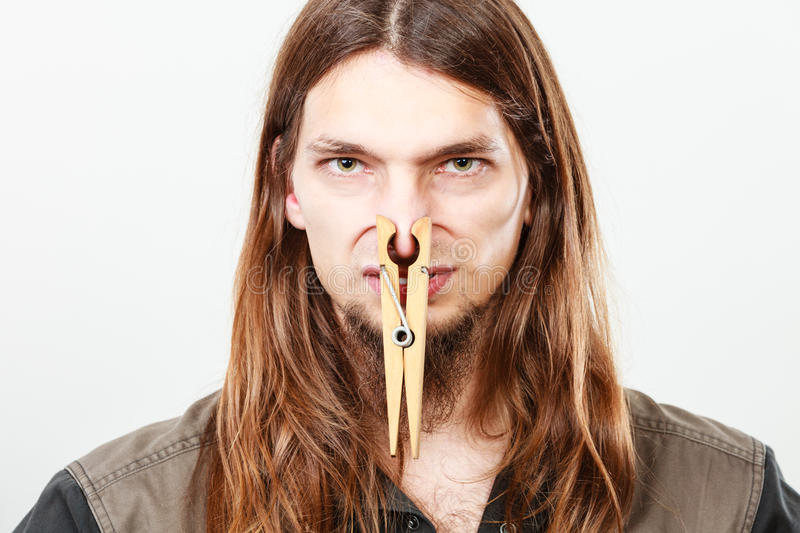 Man with clogged nose by clothespin royalty free stock photography
