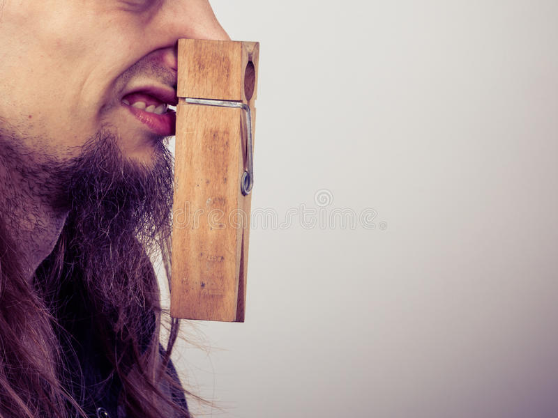 Man with clogged nose by clothespin royalty free stock images