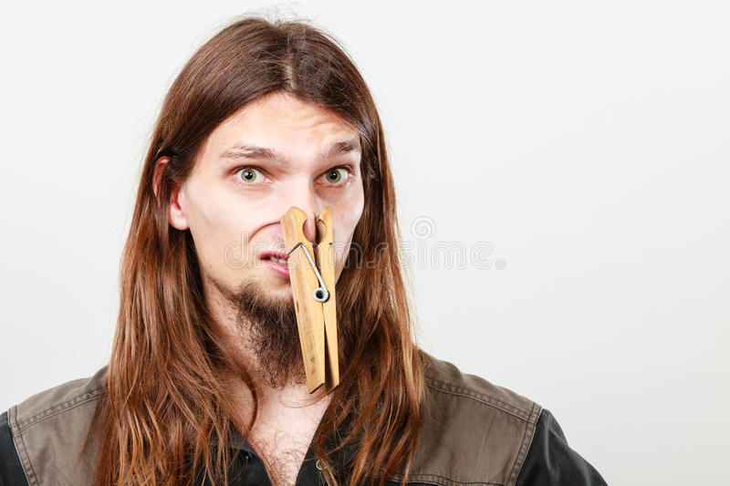Man with clogged nose by clothespin royalty free stock photos
