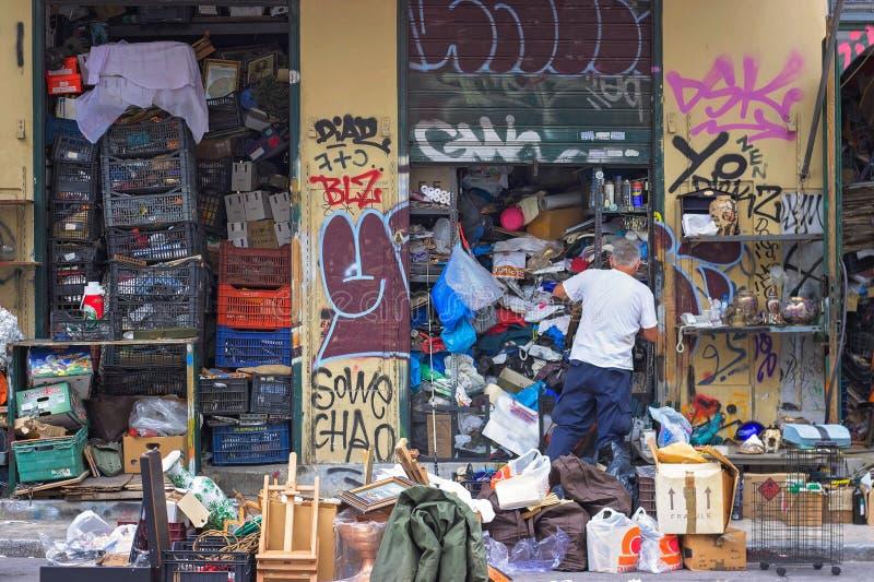 Man closing his shop at flea market in Athens. Man closing his shop at flea market in Psiri area, Monastiraki, Athens, Greece royalty free stock image
