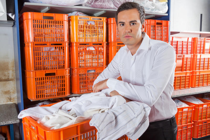 Man With Clothes Basket Standing In Laundry royalty free stock photos