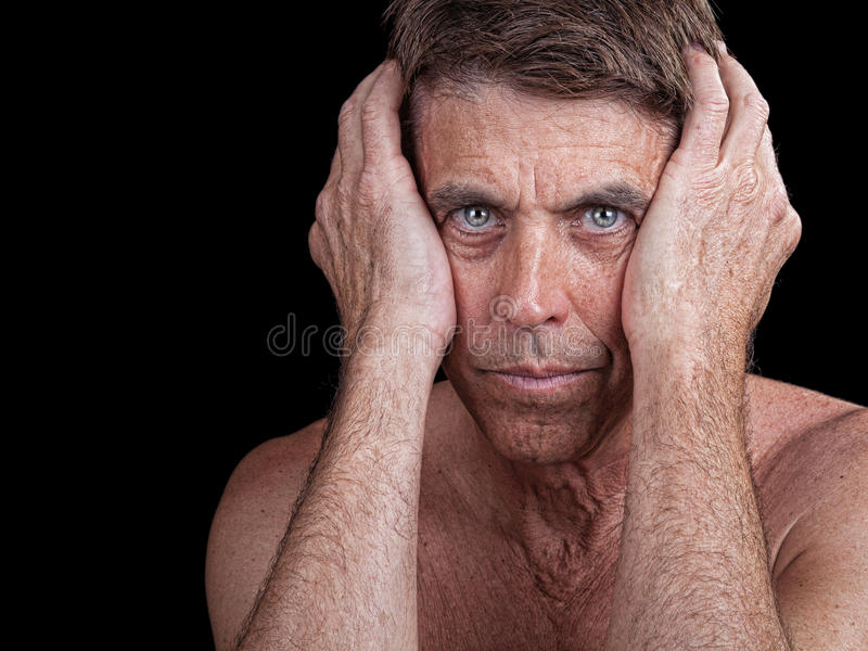 Man Clutching his Head stock photography