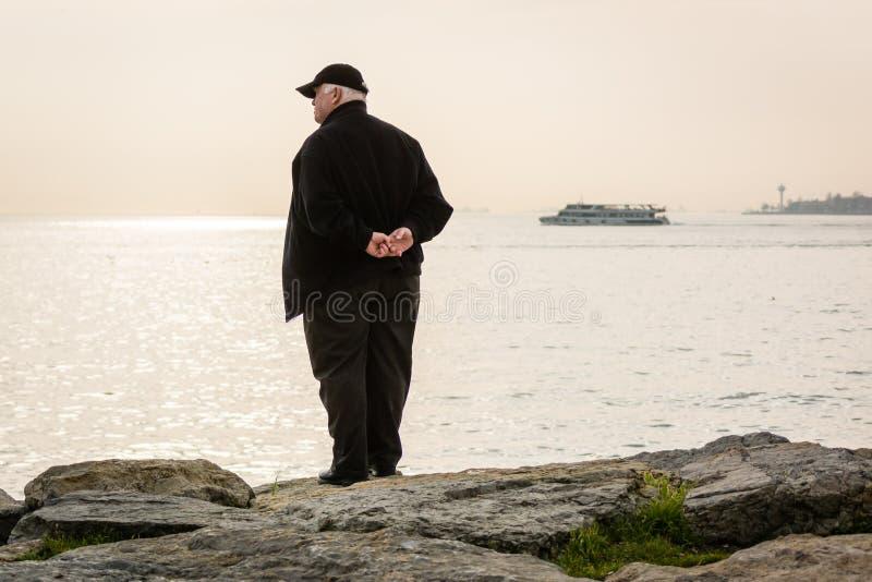 Man on the coast of Bosphorus royalty free stock images