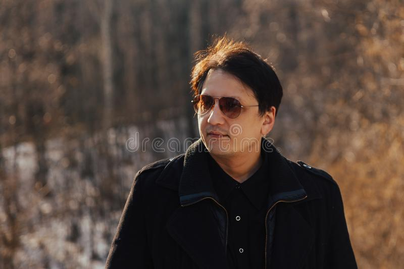 Man in coat and glasses royalty free stock photo