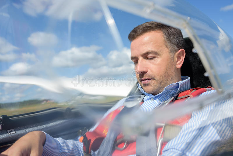 Man in cockpit sailplane. Man in cockpit of sailplane royalty free stock photography