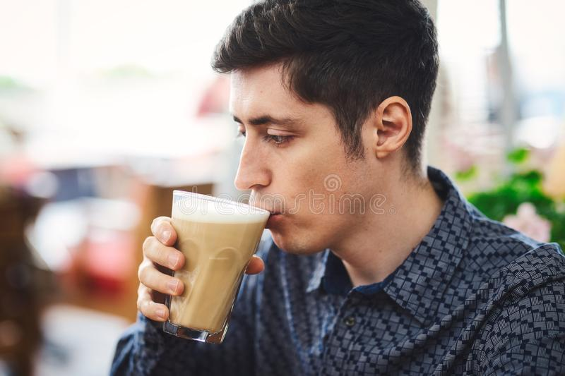 Man`s portrait with coffee latte royalty free stock images