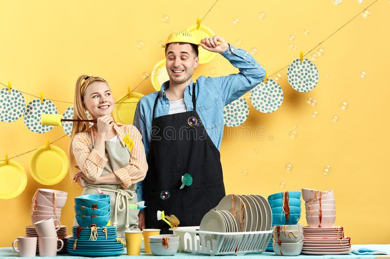 Man with colander on his head while his wife looking at royalty free stock photography