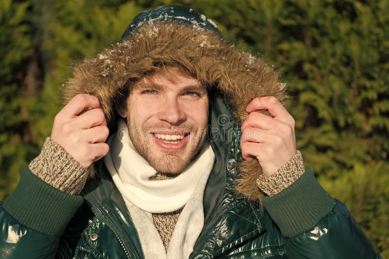 Man. It is cold outside. Forest in snow. Fresh air. Vacation and traveling in winter. Happy man on winter holidays. Snowy weather. Trendy winter coat. Winter stock photo