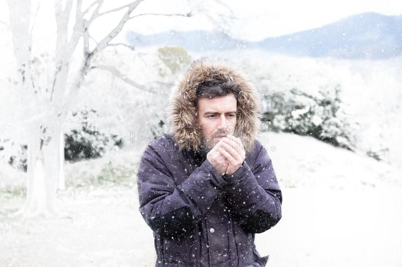 Man in cold and snowy weather storm in winter. Man in winter season and snowy day stock photography