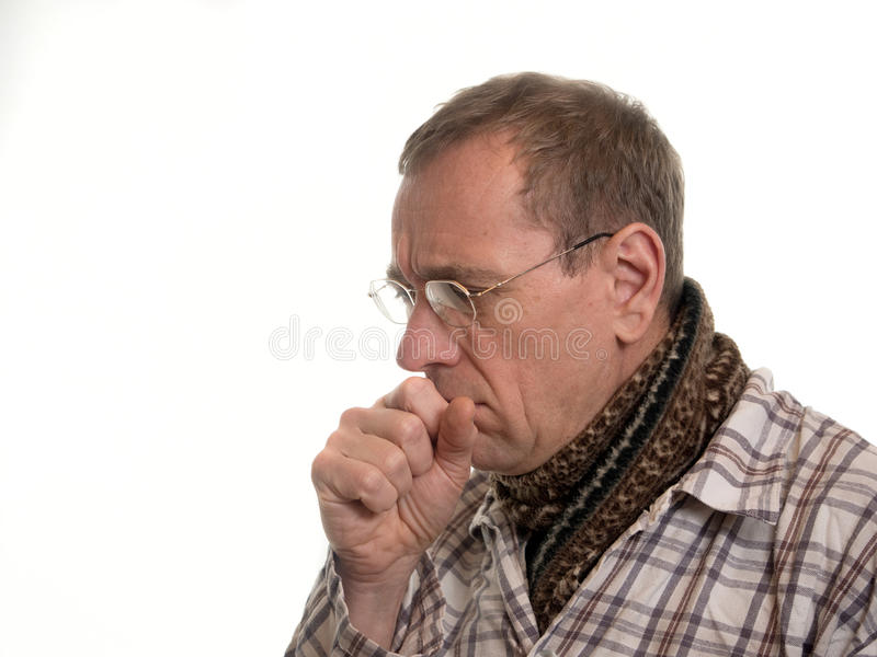 Man with a cold. Man with cold in striped pajamas stock image