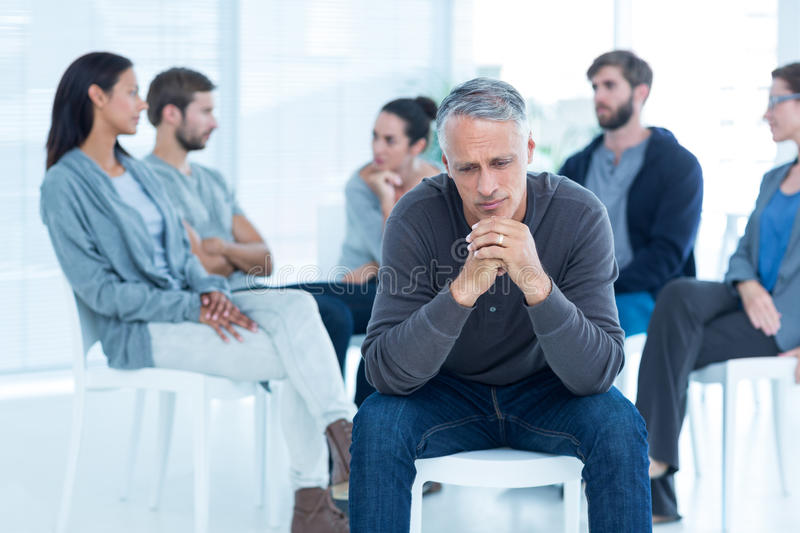 Download Man Comforting Another In Rehab Group At Therapy Stock Image - Image of patients, patient: 54774441