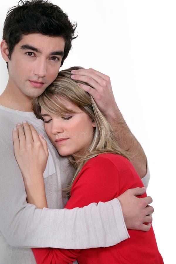 Free Man Comforting His Girlfriend. Stock Photo - 51849610