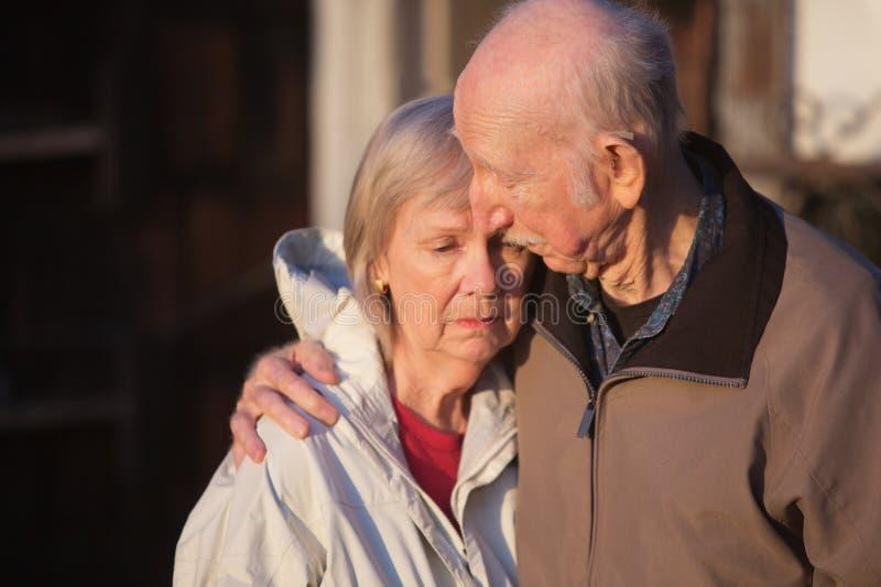 Man Comforting Sad Woman royalty free stock photos