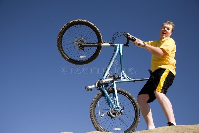 Man Coming Off Bike Stock Photos