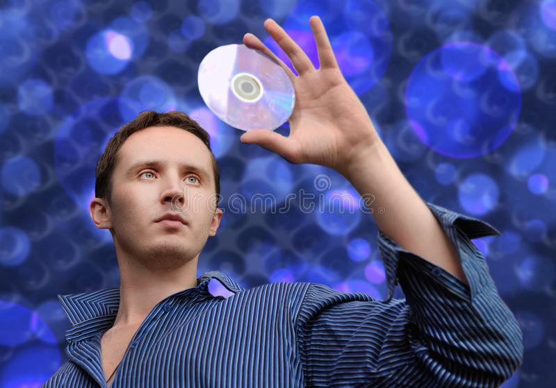Man with compact disc. In his hand royalty free stock images