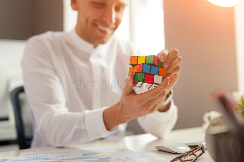 Man completing the Rubik`s cube stock photos