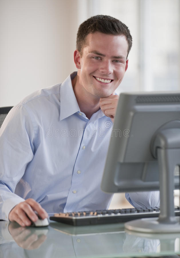 Download Man on Computer stock image. Image of cheerful, sitting - 10545539