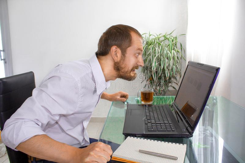 The man at the computer is angry royalty free stock images